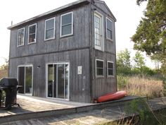 A small, off-grid home on the Patuxent River in Southern, Maryland. Small House Swoon, Farm Stay, House On A Hill, Carriage House, Off The Grid, Shed, House Inspirations, Outdoor Structures, Small Homes