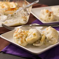 Mushroom Stuffed Shells - This vegetarian stuffed pasta dish is filled with mushrooms and ricotta and topped with a creamy cauliflower sauce (no cream involved!)