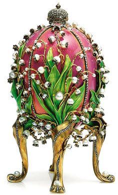"""""""Lilies of the Valley"""" - Fabrege created this egg for the Tsarina as an Easter gift from Tsar Nicholas II in 1898.  It is made from gold, ormolu (gilded bronze), vermeil (gilded silver), enamels, pearls and small diamonds."""
