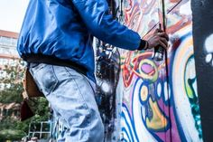 Man in Gray Shirt Standing on Gray Steel Ladder Painting Black White and Red Graffiti on Concrete Wall Outdoors · Free Stock Photo Aerosol Paint, Traditional Paint, Wall Writing, Criminal Defense, Adobe Photoshop Lightroom, Man Photo, Grey Shirt, Free Stock Photos