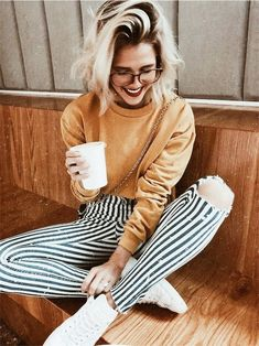 Striped pant with mellow yellow sweater and white sneakers