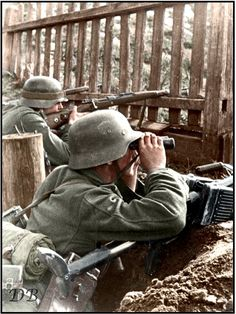 German soldier with a 7.92-mm anti-tank rifle PZB-39 (Panzerbüchse 39) monitors out of the trench on the Eastern Front. ca 1941