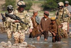 #ISAFNATOForcesInAfghanistan ..... The #Australian Reconstruction Task Force #PRT is followed by enthusiastic #Afghan boys on a river crossing during a reconnaissance for an all-weather crossing at Talani, Uruzgan, southern #Afghanistan to increase economic opportunity in the region #ISAFnic AustralianArmyAustralian Defence Force