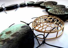Kelly Munro - neckpiece, wood, metal, thread