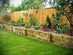 Raised Beds inside fence...love the look of this!!! And the Dogs would stay out of the flowers when they are running!