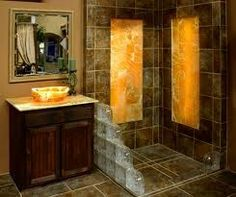 Calcite Inlayed shower walls and vessel sink back lit