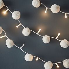 This gorgeous white pompom light garland makes a magical display wherever it is - over a mirror, bed or indoor tree. Each garland has 20 soft white led lights on a white covered cord with traditionally made pompoms. Christmas Bunting, Easy Christmas Decorations, Crochet Christmas Trees, Simple Christmas, Christmas Crafts, White Christmas Lights, Pom Pom Decorations, Xmas, Light Garland