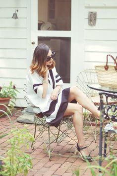 Emilee Anne wearing Madewell Poncho Dress // Swedish Hasbeens Sandals // L'Occitane Straw Tote // Celine Sunglasses // Gucci Watch