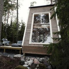 The MicroHouse's diminutive size—just 96 square feet—was determined by the maximum allowed for construction without a permit. To make the most of the living space, the designer and owner included a loft area for sleeping; a large connected deck extends the living area outdoors.