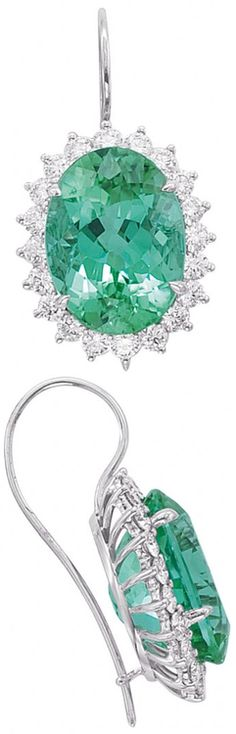Handcrafted 18-karat white gold earrings set with oval-shaped 16.91-carat mint green tourmalines and 1.86 carats of diamonds by Tamir. Via CIJ Jewellery Magazine.