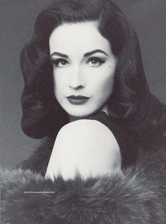 Dita Von Teese. I like her elegance. I think she advocates people to still wear outfits with class and elegance. I like her mole below her left eye. I just love her.