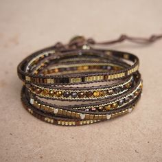 This wrap bracelet features a collection of beads crafted to a strand of brown cord in a variety of shapes. ✧ Mix include : Crystal, Silver plated nugget ✧ Length : 82cm with adjustable. ✧ Closure : Button ✧ Fits a 6 to 7 inch wrist wrapped 5 times. . PLEASE NOTE : The handcrafted nature Bracelets Wrap En Cuir, Bracelet Wrap, Beaded Wrap Bracelets, Bohemian Bracelets, Hippie Jewelry, Gold Bracelets, Diamond Earrings, Charm Bracelets, Diamond Pendant