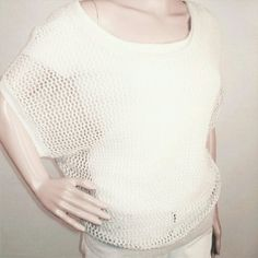 Vince mesh top cream net knit linen Vince cream open knit top. It's light to medium weight and very versatile. It will also look cool over a bathing suit or just a year. Wide scoop neck  and short off the shoulder dolman sleeves. Vince Tops