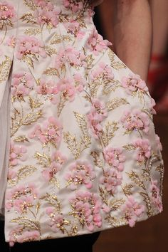 I think this embellishment has been made with silk flower petals and bugle beads (on the leaves). It's an interesting approach for the floral.