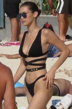 Bella Hadid wearing Zigilane Base Bikini and Are You Am I Binx Chain Choker
