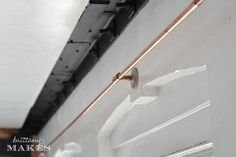 copper plumbing as a curtain rod, genius because it would be so much more sturdy and long than the ones from say target!