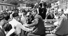 Rep. George McGovern joins Sen. John F. Kennedy on the campaign trail in June 1960. Both went on to victory, Kennedy as president and McGovern as senator. They greet the crowd in Sioux Falls, S.D.