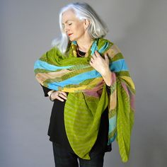 Carolyn Cowan. I especially love the longer gray hair with a mix of classic/bohemian. Can't wait til I'm all the way there.