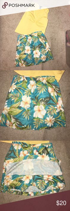 Beautiful Summer Outfit perfect for vacation Beautiful Summer Outfit perfect for vacation . Sleeveless top with 5% spandex and skirt with built in shorts. Ships from a smoke free and pet free home. Other