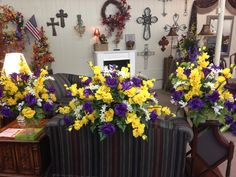 Silk cemetery tomb topper and vases using purple and yellows with white fillers. May 2015. (Shook)
