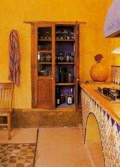 Hacienda Style Kitchen. I especially like the interior color of the cabinet!