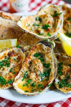 Chargrilled Oysters- Filled with a lemony, garlicky, butter sauce that are topped with cheese and chargrilled until the cheese has melted and turned golden brown. (Serve with crusty bread to soak up all of that buttery saucy goodness!)