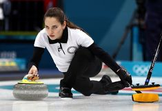 Anastasia Bryzgalova of Russia delivers a stone in the curling mixed doubles round robin session one at Gangneung Curling Center on February 8, 2018.