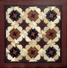 pieced quilt, hand quilted