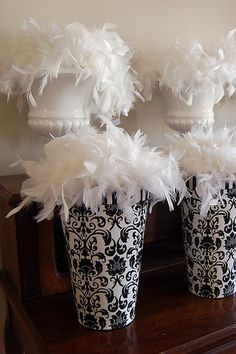 Here's a great idea for a black and white party--grab a fun container, add a bit of a feather boa, and voila' you've got an easy theme decoration.