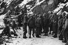 American soldiers, 33 man patrol,  representing all the battalions of the 334th Infantry Division in Filly (between Houffalize and La Roche-en-Ardenne).