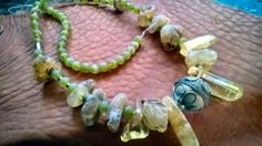 Gorgeous Amber petals and Sea Amber beads with green matte jade and Turkish alpaca bead mixed strand