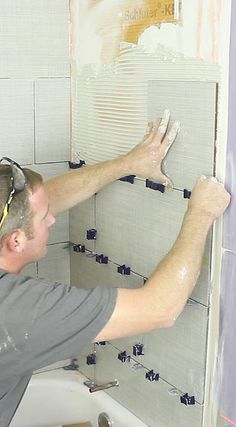 Learn how to tile a shower with professional tips https://www.homerepairtutor.com/how-to-tile-a-shower-wall
