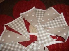Neutral bunting in spots and checks available from Bella and the Moo