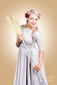 Vintage woman holding old fashion broom when cleaning and tiding. Spring clean concept by Ryan Jorgensen