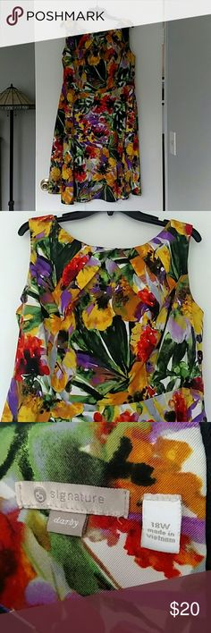 Bold Floral Fit n Flare Dress So many colors - Green, yellow, orange, gold purple.  Feels like Hawaii!  I got compliments everytime I wore this dress!!! Dress Barn Dresses