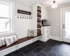 Spacious entryway in white and wood