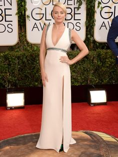 """Since bursting on the scene as one of Hollywood's favorite new leading ladies to watch out for, """"Wolf of Wall Street"""" star Margot Robbie has done nothing but kill it on the red carpet with one gorgeous look after another. Metallic detail gives this creamy white Gucci dress an added bit of edge."""