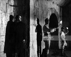 American actor Orson Welles (1915 - 1985, left) as the fugitive Harry Lime in…