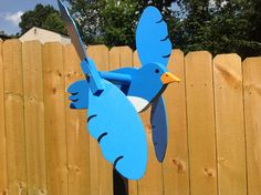 blue bird whirligig bluebird wooden hand made folk art whirligigs wood yard art garden whirligig, yard ornament Garden Spinners, Wind Spinners, Blacksmith Power Hammer, Unique Bird Feeders, Wood Yard Art, Yard Ornaments, Wood Bird, Garden Yard Ideas, Wooden Animals