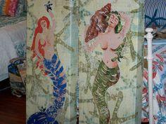 Mermaid wall art made of light weight metal.