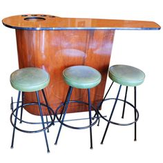 Walnut and metal Mid-Century bar with cutting board at the back and the space for glasses and an ice bucket