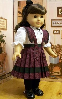 Samantha Parkington Hairstyle: half ponytail Footwear: black tights, black Mary Jane shoes blouse and skirt white and burgundy 1900s