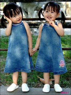 Twins - hearing no evil, speaking no evil, but definitely looking for mischief!