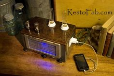 Radio Lamp $260.00  Contains blue LED in the front part of the radio and a charging station on the side.