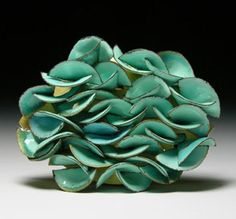 Jacqueline Ryan – Brooch (2008). 18 ct gold, enamel.......Connie Fox: This beautiful aqua color unifies the piece.