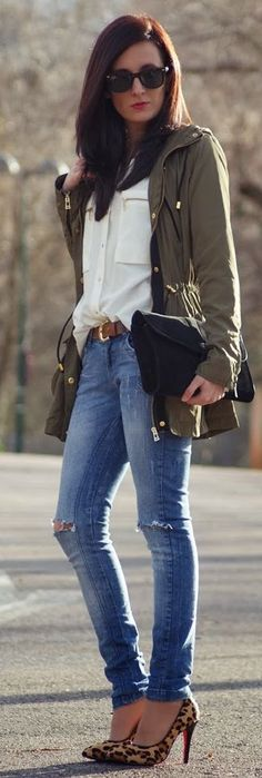 Spring transition in denim, breezy blouse, and army green parka.