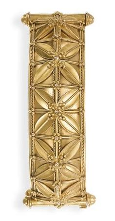 AN ARCHAEOLOGICAL REVIVAL GOLD BANGLE, BY GIULIANO. The hinged burnished gold bangle composed of ten foliate and ropework panels, circa 1870, with maker's mark CG for Carlo Giuliano. Unusual Jewelry, Antique Jewelry, Vintage Jewelry, Gems Jewelry, Jewelry Box, Love Bracelets, Gold Bangles, Makers Mark, Solid Gold