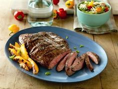 Balsamic Marinated Flank Steak (updated) -- Flank Steak benefits from a tenderizing marinade of balsamic vinegar, basil, Dijon mustard and garlic.