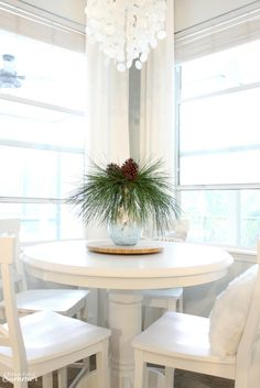 Add New Life to Your Home With This New Year's Resolution | House Full of Summer blog adding greenery to your home, decorating with plants, fronds, trimmings, winter decor, home decor, coastal home interior, capiz chandelier, decor on a budget, spring decor ideas, white hydrangeas, hamptons style, white breakfast nook, extra long white curtains, pine trimmings, fresh pine,