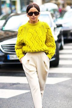Miroslava Duma wears a yellow cable-knit sweater with high-waisted trousers and cool sunglasses